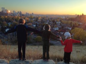 Three kids on hill